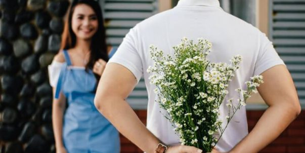 Man Holding Baby's Breath Flower While Dating